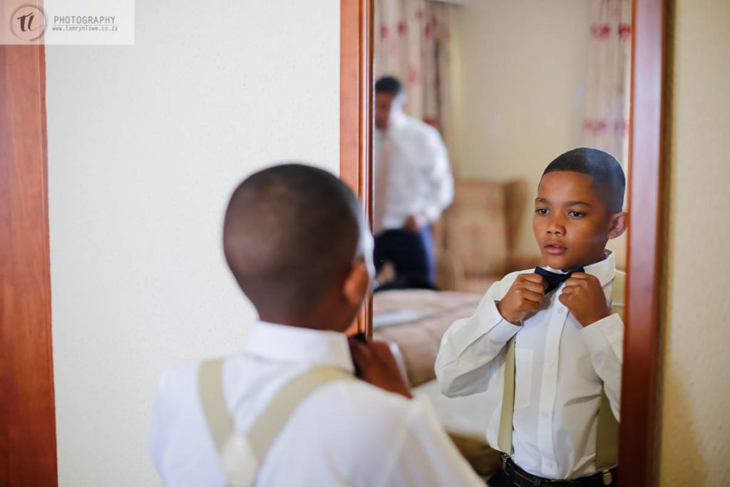 Ring bearer getting ready for wedding