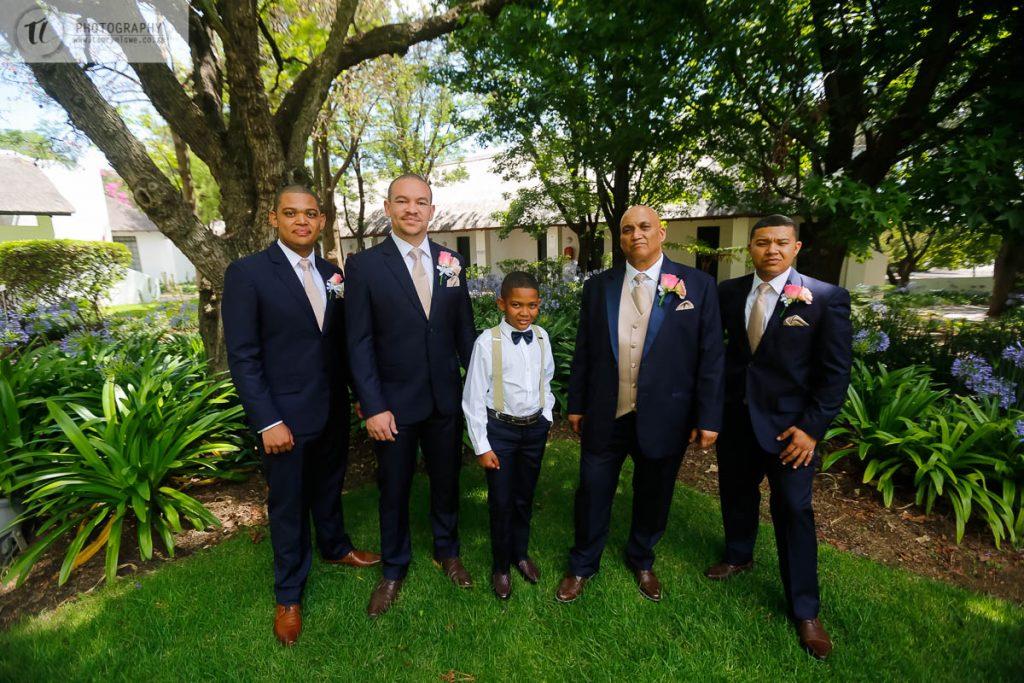 Groom & Groomsmen posing before wedding