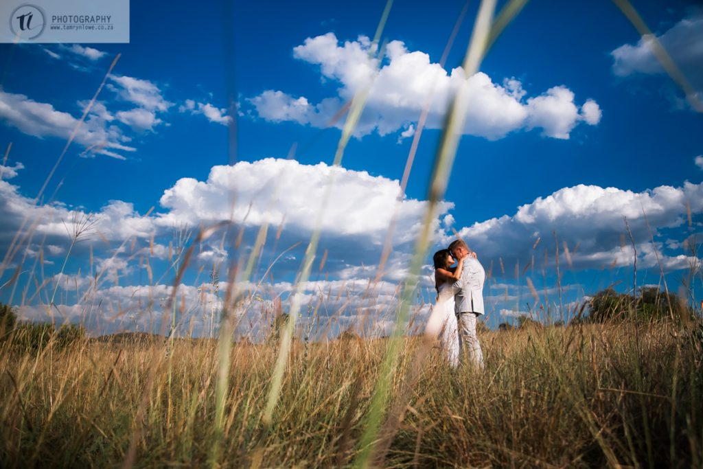 Bride & Groom through veld