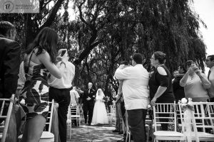 Bride walking down the isle with guests in foreground