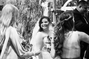 Bride smiling at bridesmaid