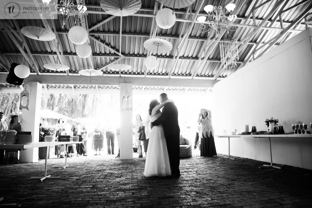 Black and white of Bride & Groom dancing