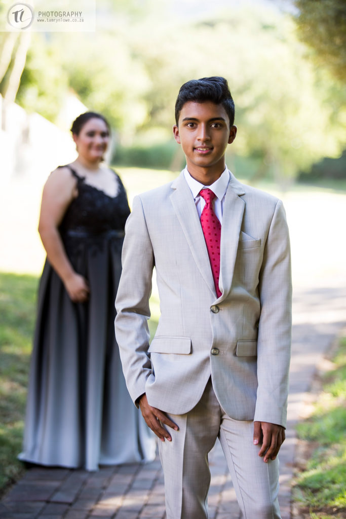 Formal couple standing together before matric dance